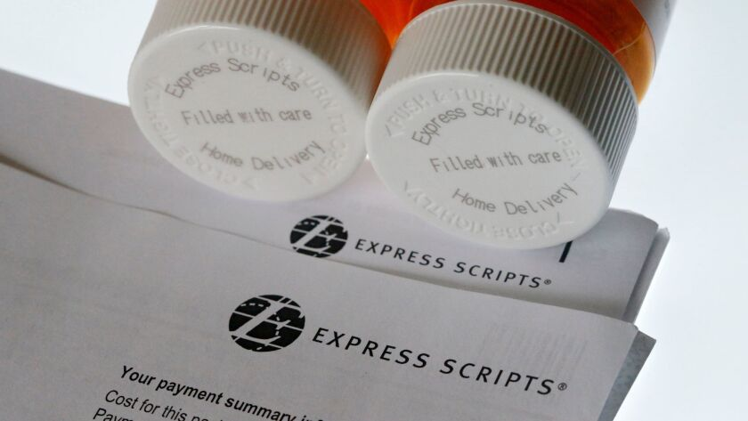FILE - In this July 25, 2017, file photo, Express Scripts prescription medication bottles are arrang