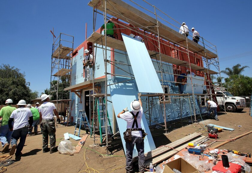 Builders constructing a single-family home in Escondido where the family of a wounded veteran will live by the end of the year