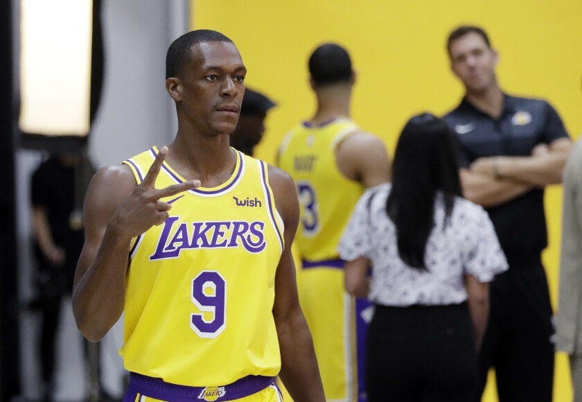Los Angeles Lakers' Rajon Rondo (9) poses for photos during media day at the NBA basketball team's practice facility Monday, Sept. 24, 2018, in El Segundo, Calif.