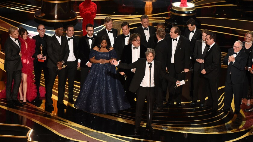 "Producers of ""Green Book"" Peter Farrelly and Nick Vallelonga accept the Oscar for best picture at the Dolby Theatre in Hollywood on Feb. 24."