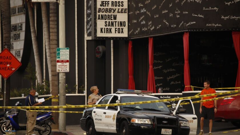 Los Angeles County Sheriff detectives investigate a shooting death in West Hollywood in 2015.