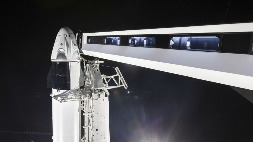 In this Jan. 3, 2019 photo, provided by SpaceX, the crew access arm is extended to the SpaceX Crew