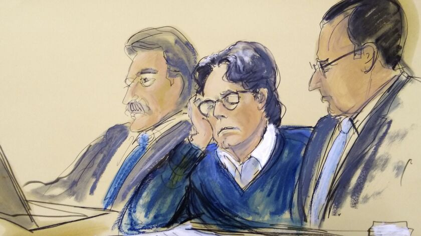 In this courtroom artist's sketch, defendant Keith Raniere, center, sits with attorneys Paul DerOhan