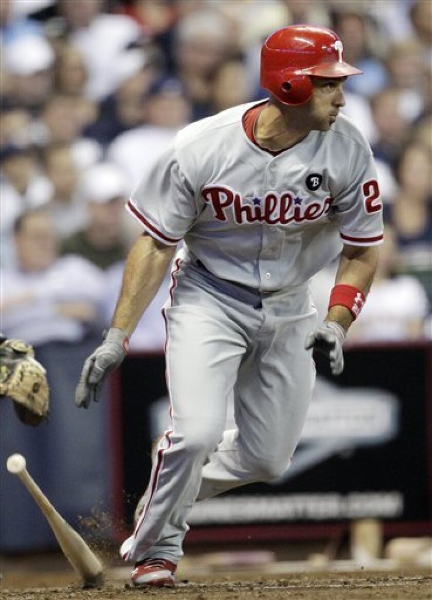 Philadelphia Phillies' Raul Ibanez hits a run-scoring single during the seventh inning of a baseball game against the Milwaukee Brewers, Friday, Sept. 9, 2011, in Milwaukee. (AP Photo/Morry Gash)