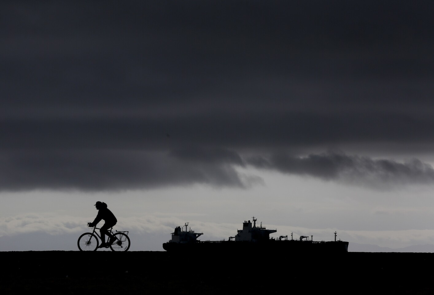 LONG BEACH,CA., FEBRUARY 7, 2017: rides along the boardwalk at Kite Beach in Long Beach after two days of storms brought heavy rains to Southern California.