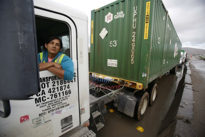 Truck driver Socorro Heredia waited in line at the Otay Mesa commercial border crossing to enter the United States on Dec. 23. A new port of entry being planned for two miles east of this one is aimed at relieving the congestion.