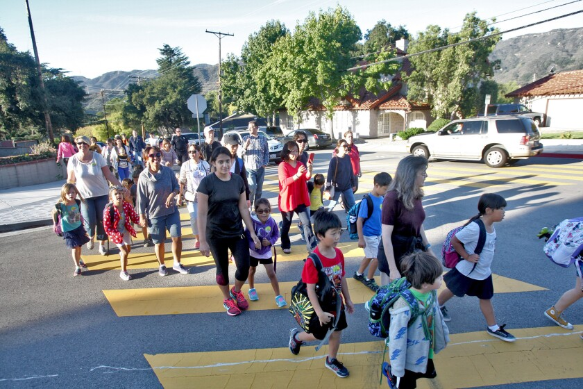 Children and their parents arrive at Lincoln Elementary School in La Crescenta on Wednesday, Oct. 7, 2015.
