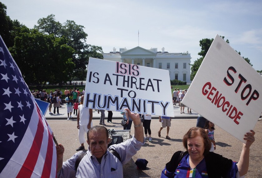 Demonstrators rally against the Islamic State militant group, also known by the acronym ISIS, outside the White House on Aug. 16.