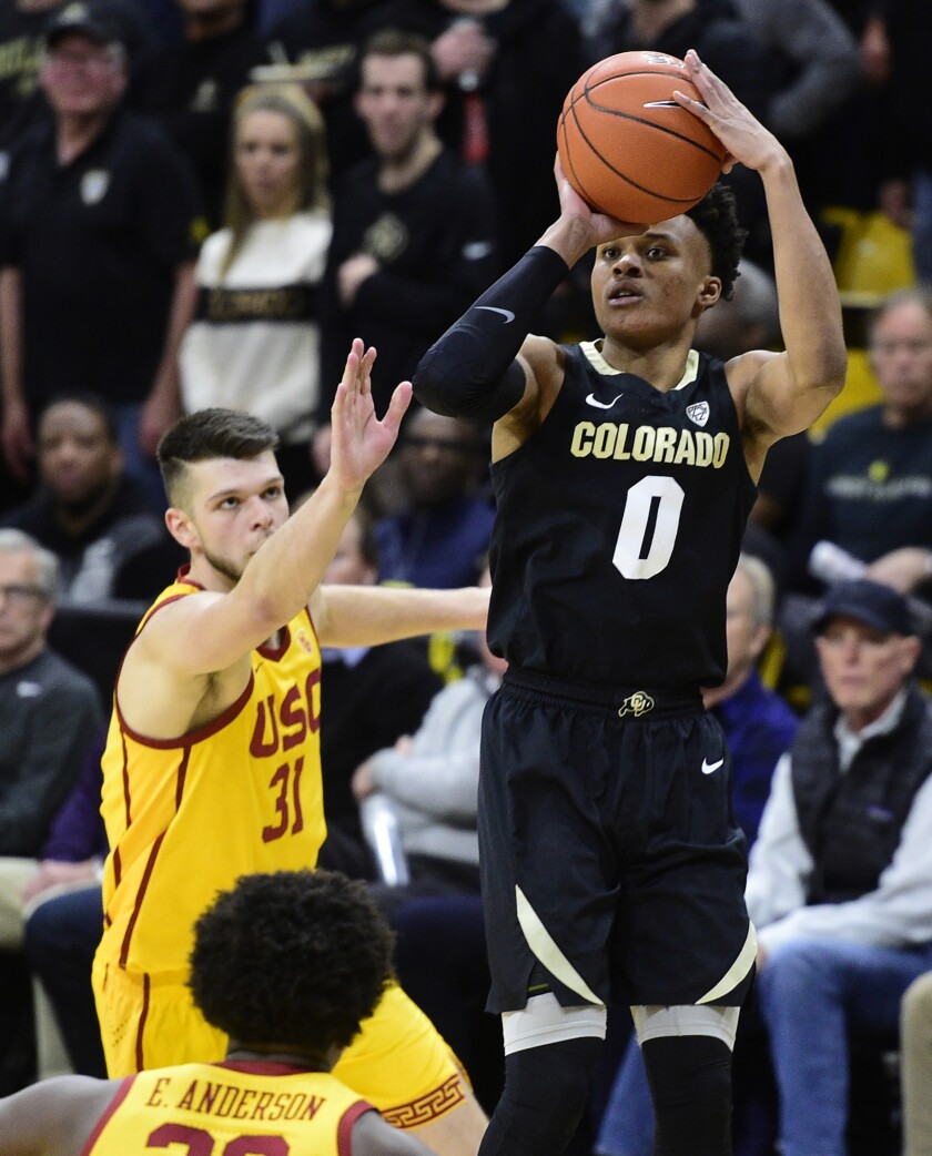 Colorado guard Shane Gatling puts up a 3-point shot in front of USC forward Nick Rakocevic during the second half of a game Feb. 20 at CU Events Center.