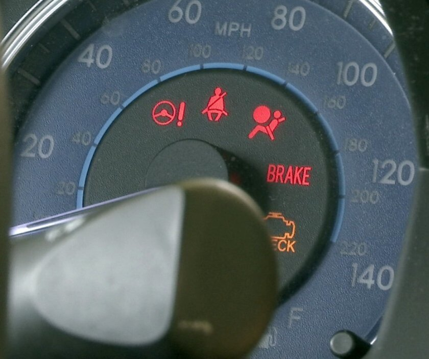 In this Aug. 16, 2016, image taken from video, the dashboard of a Toyota sedan in York Township, Mich., displays various indicator icons, including a seat belt warning sign that is accompanied by an audio alert. As more features have been added in cars and trucks, the number of sounds has grown, an