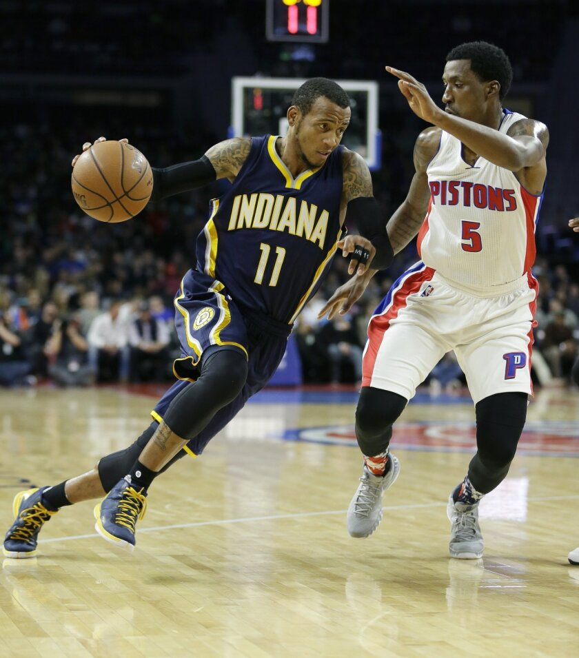 Indiana Pacers guard Monta Ellis (11) drives to the basket as Detroit Pistons guard Kentavious Caldwell-Pope (5) defends during the first half of an NBA basketball game, Tuesday, Nov. 3, 2015, in Auburn Hills, Mich., (AP Photo/Carlos Osorio)