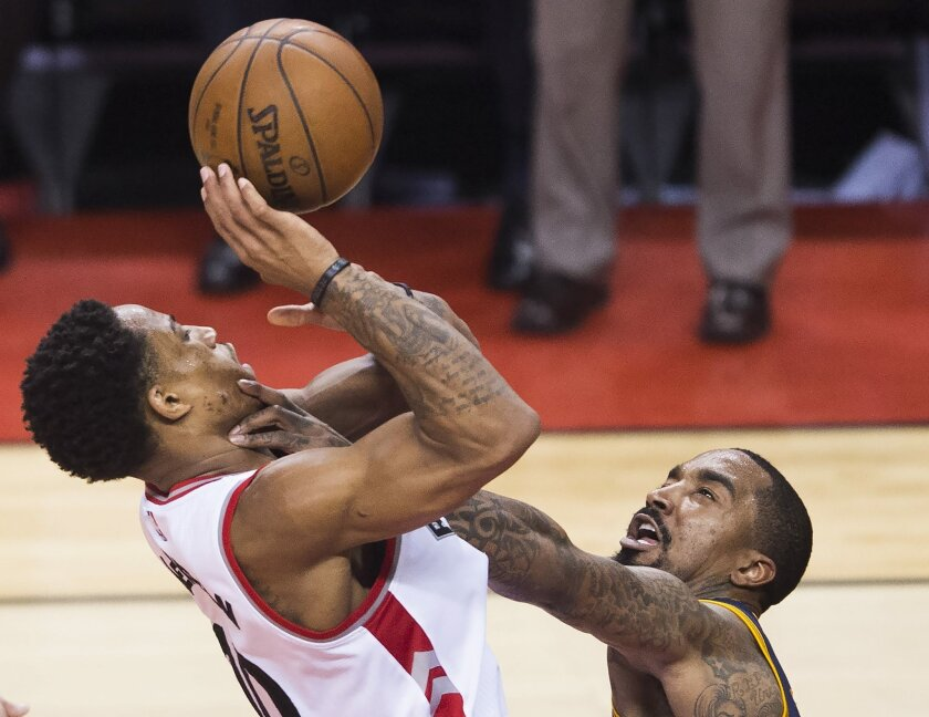 Toronto Raptors guard DeMar DeRozan (10) is fouled by Cleveland Cavaliers guard J.R. Smith (5) during the second half of Game 6 of the NBA basketball Eastern Conference finals, Friday, May 27, 2016, in Toronto. (Nathan Denette/The Canadian Press via AP)