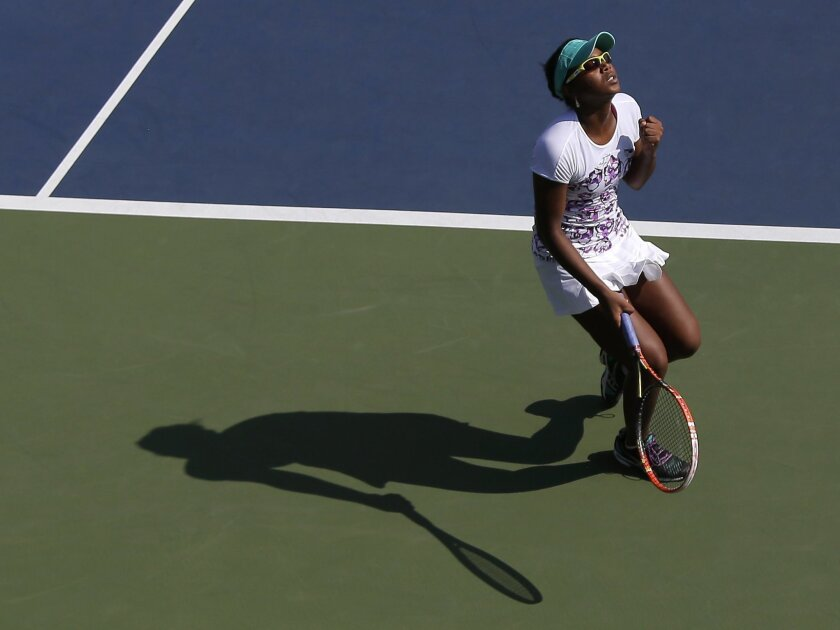 Vicky Duval, of the United States, reacts after winning a point against Luksika Kumkhum, of Thailand, during the first set of a U.S. Open qualifying tennis match, Tuesday, Aug. 25, 2015, in New York. The qualifying round is Duval's second tournament this year after missing last season to undergo treatment for cancer. Duval won the match. (AP Photo/Julie Jacobson)