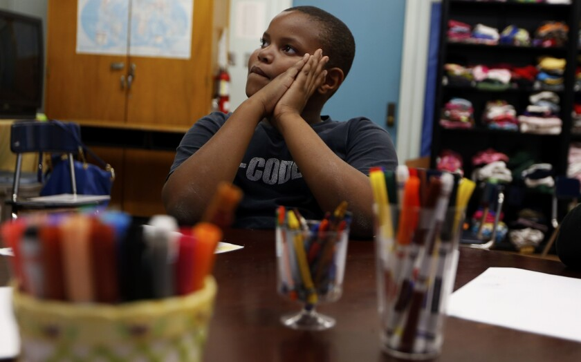 Christopher Bland, a student at West Athens Elementary School in South L.A., participates in an art-based counseling program called Share and Care.
