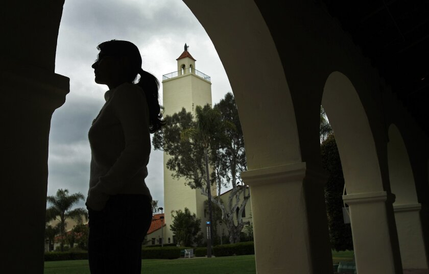 """Trinidad, an undocumented immigrant who didn't want her full name used, received her master's degree in public health at San Diego State University. She may qualify for """"deferred status"""" under the Obama administration's new immigration policy. / Photo by K.C. Alfred * U-T"""