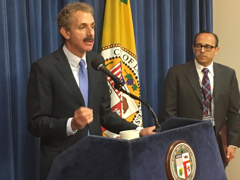 City Atty. Mike Feuer on Thursday announced a $13.5-million settlement with U.S. Bank over its repossessed properties.