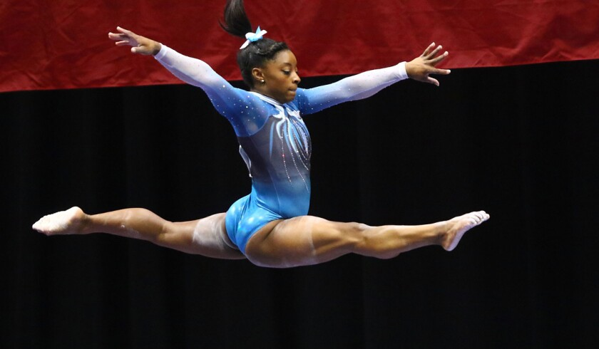 Simone Biles competes on the balance beam during Day 2 of the 2016 P&G Gymnastics Championships on Sunday.
