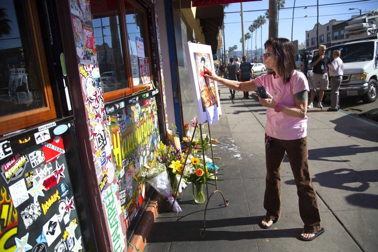 Lori Deason from Ocean Beach stopped by the well known Hodad's Burger eatery in Ocean Beach to pay her respect to Mike Hardin.  Throughout the day mourners gathered and left items in front of the Ocean Beach eatery in a makeshift memorial.