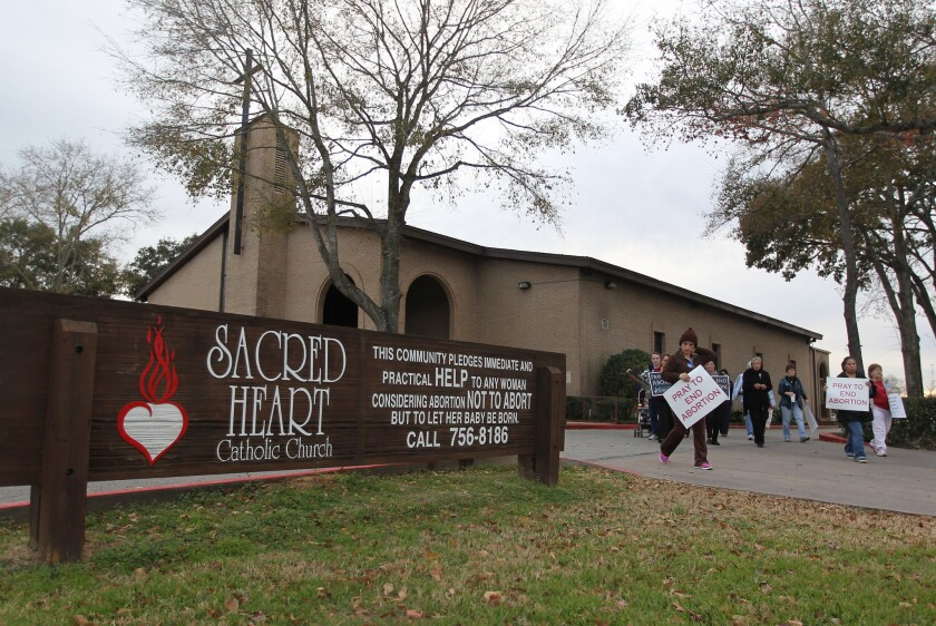 Antiabortion protesters gather at Sacred Heart Catholic Church in Conroe, Texas, in January to mark the 41st anniversary of Roe vs. Wade, the Supreme Court ruling that struck down antiabortion laws. Texas is one of the battlegrounds over new legislation designed to restrict abortion.