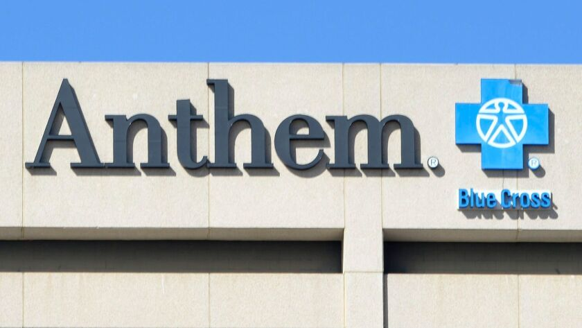 The Anthem Blue Cross logo is seen atop the company's office building in Woodland Hills, Calif. in 2015.