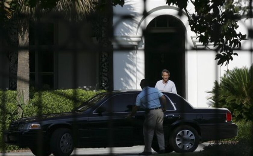 South Carolina Gov. Mark Sanford leaves the Governor's Mansion Friday, July 3, 2009 in Columbia, S.C. A day earlier, his spokesman said Sanford planned to fly to Florida accompanied by state security for the long holiday weekend. (AP Photo/Mary Ann Chastain)