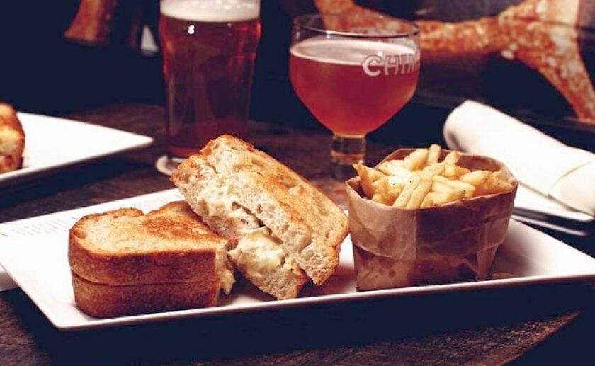 You can add a lot of toppings to the Sessions Public grilled sandwich, served on Tuesdays.