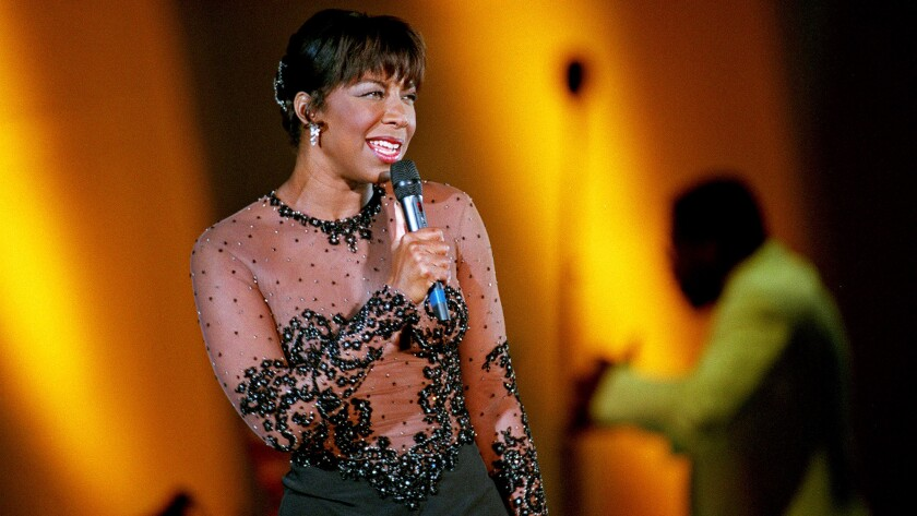 Natalie Cole sings her songs and her father's (and Billie Holiday's, among others) at the Hollywood Bowl in 1995.