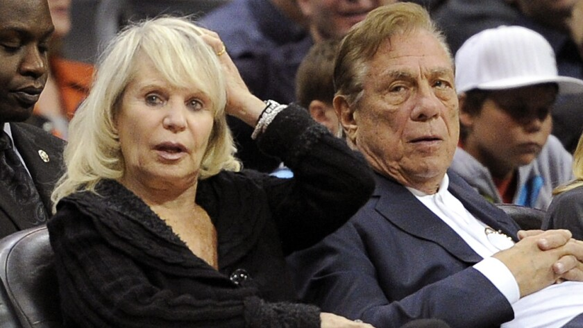 Clippers owners Shelly, left, and Donald Sterling watch the Clippers play the Detroit Pistons in 2010. Shelly Sterling is attempting to rush a sale of the team before the NBA owners will be asked to strip control of the team from both of the Sterlings.