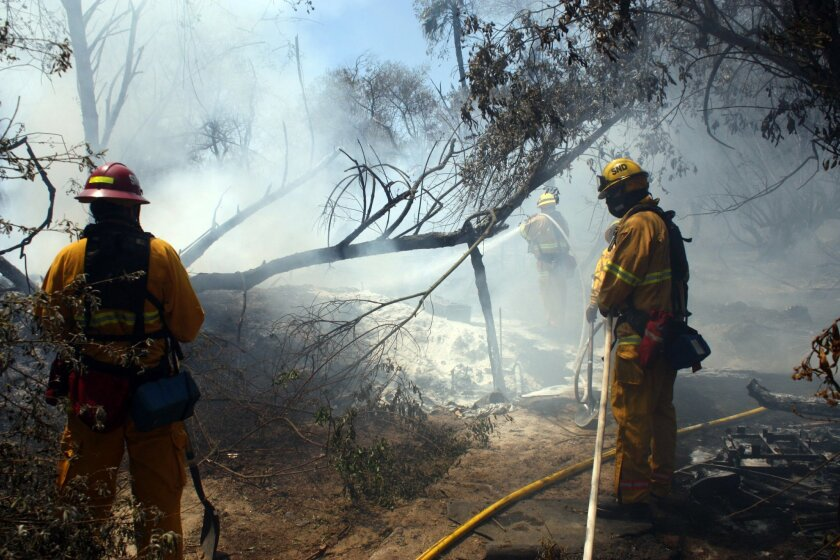 A badly burned body was found as crews worked to douse a second-alarm brush fire near Interstate 805 in National City Wednesday afternoon, a fire official said.