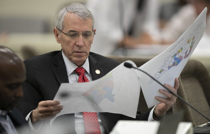 North Carolina state Rep. John Szoka looks over a redistricting map during a committee meeting at the Legislative Office Building in Raleigh, N.C.