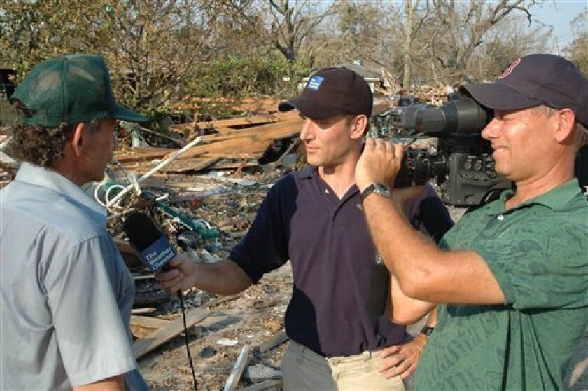 In this undated photo provided by the Weather Channel, meteorologist Mike Bettes, center, interviews a victim of hurricane Katrina. Bettes arrived in Joplin, Mo. right after the recent tornado and began doing live reports.  (AP Photo/The Weather Channel)