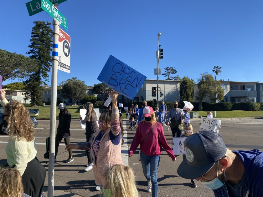 Parents and students from the La Jolla Cluster schools protest ongoing school closures Feb. 18 near Bird Rock Elementary.