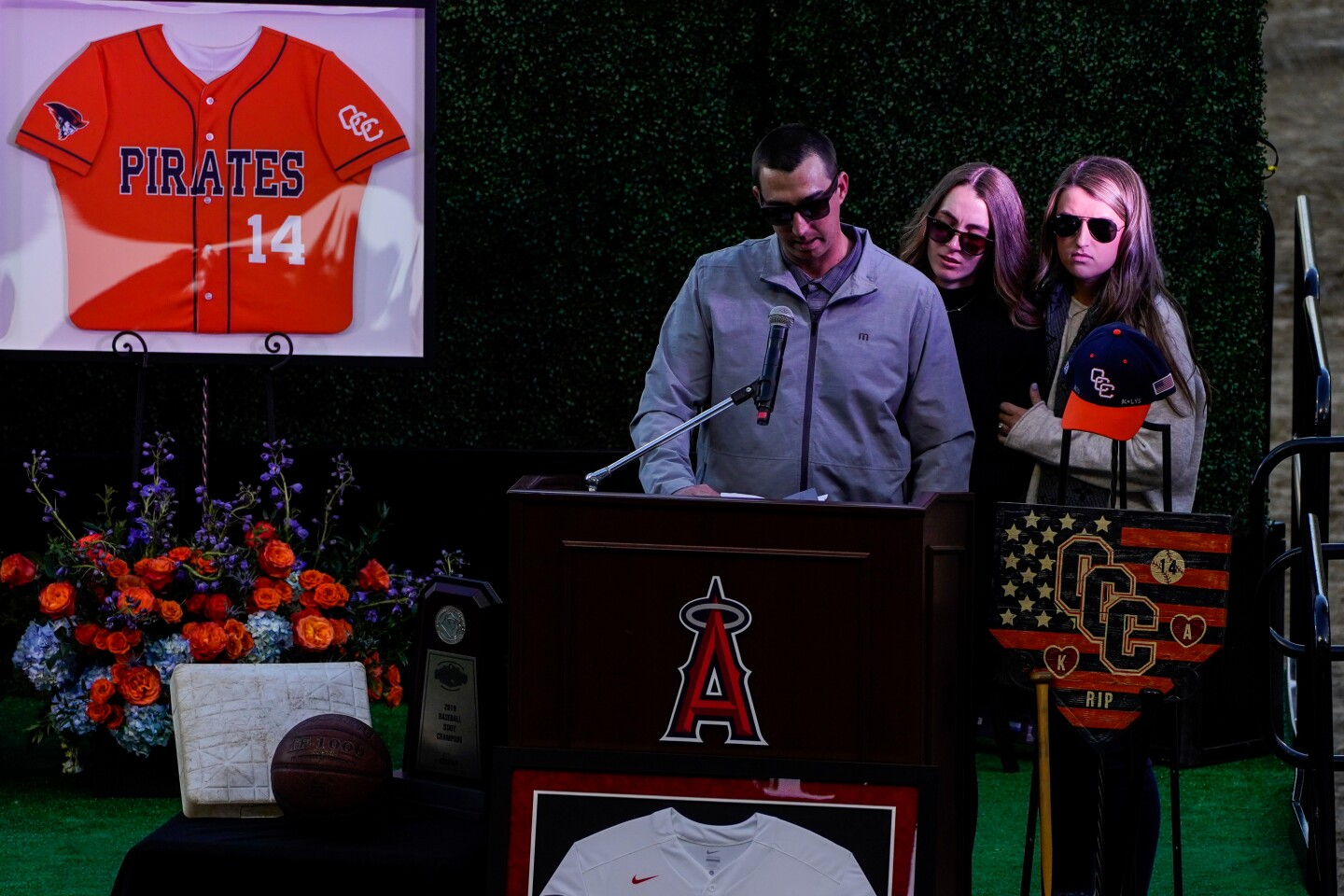ANAHEIM, CALIF. - FEBRUARY 10: JJ Altobelli, accompanied by Lexi Altobelli and Carly Konigsfeld speaks during a celebration of life ceremony at Angel Stadium on Monday, Feb. 10, 2020 in Anaheim, Calif. to honor the lives of John, Keri and Alyssa Altobelli, who were among the nine killed in a helicopter crash that also claimed the lives of Lakers legend Kobe Bryant and his daughter Gianna. (Kent Nishimura / Los Angeles Times)