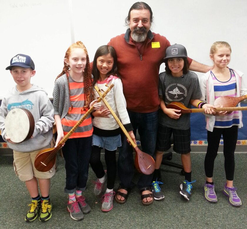 Students James, Carmen, Yu Mei, Christian, and Laine with musician Kourosh Taghavi as part of the Del Mar Heights School World Music Program.