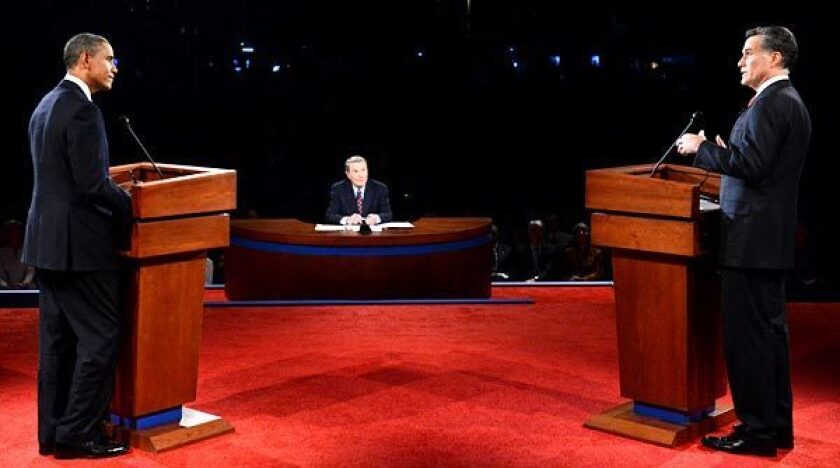 President Obama and Republican presidential nominee Mitt Romney debate from behind lecterns in 2012.