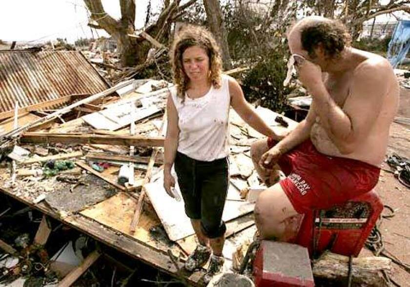 Sarah Fairchild and Bobby Chancey of Biloxi hung onto trees to survive. Their family has lost everything it owned.