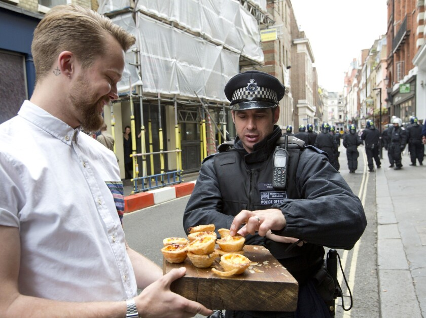 A London police officer samples wares offered by a local businessman. In Minnesota, a man was arrested and accused of shoplifting after taking a large number of samples from a grocery store.