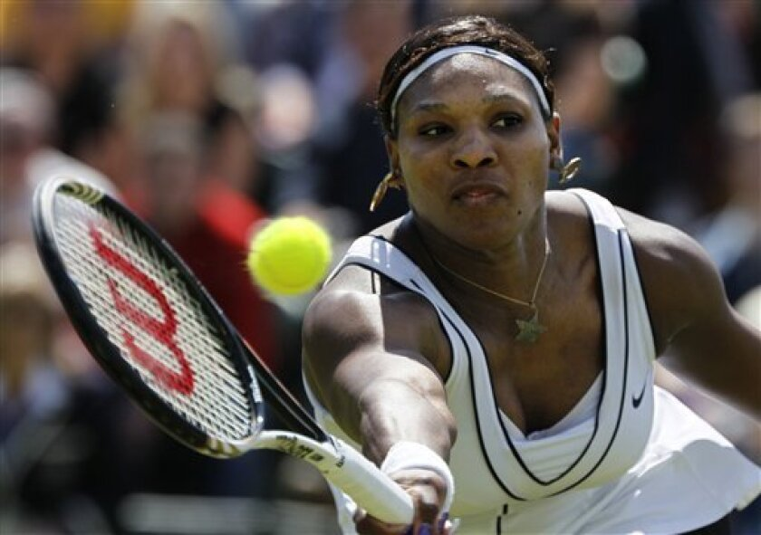 Serena Williams of the US returns a shot to Romania's Simona Halep in their match at the All England Lawn Tennis Championships at Wimbledon, Thursday, June 23, 2011. (AP Photo/Alastair Grant)
