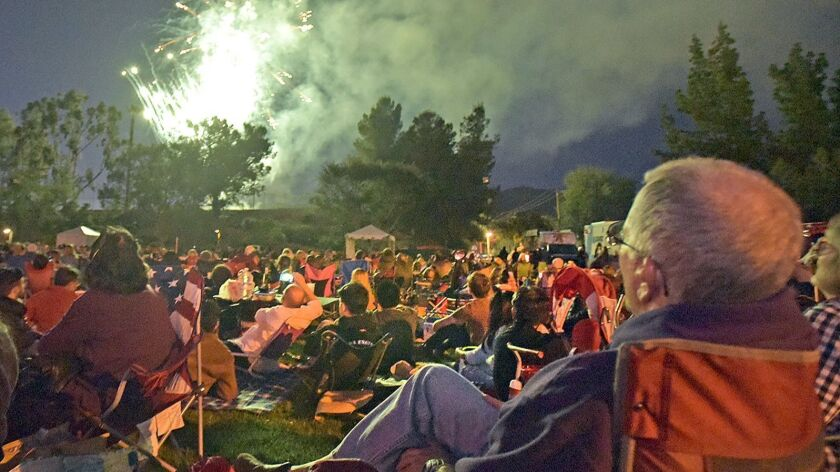 Hundreds of attendees watch the fireworks show which was part of the 45th Annual Memorial Weekend Fi