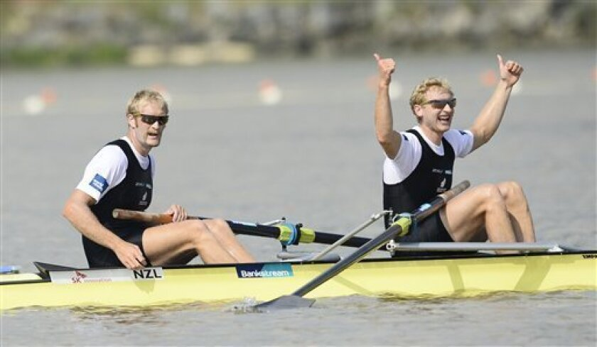 Winners Eric Murray, left, and Hamish Bond of New Zealand celebrate after the men's pair final event of the World Rowing Championships in Chungju, south of Seoul, South Korea, Saturday, Aug. 31, 2013. (AP Photo/Lee Jin-man)