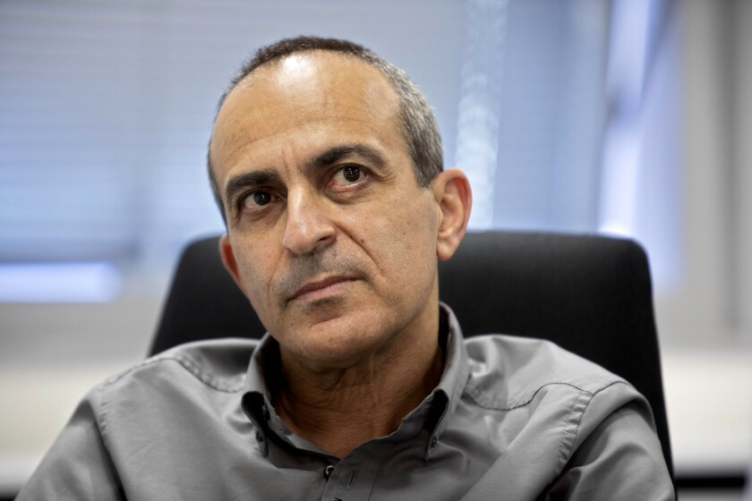 Israeli Dr. Ronni Gamzu speaks during an interview with the Associated Press at his office near the central Israeli city of Lod, Thursday, Sept. 24, 2020. Gamzu is a cancer survivor. It was that personal battle that readied him for his greatest professional challenge: steering Israel's troubled coronavirus response. (AP Photo/Sebastian Scheiner)