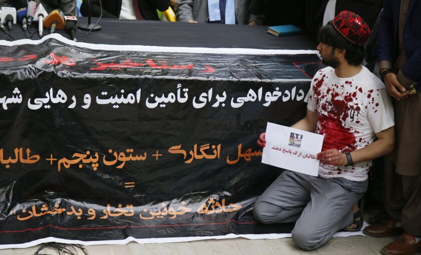 Afghan civil society members condemn the kidnapping and brutally killing of innocent Afghan passengers by Taliban who were abducted from the Kabul-Kunduz highway during a gathering in Kabul, Afghanistan