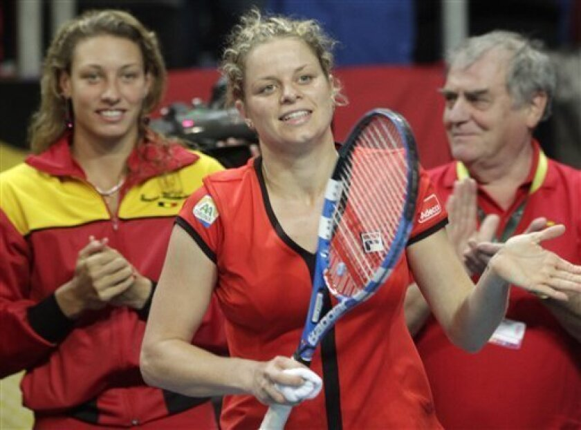 Belgium's Kim Clijsters reacts after defeating US player Melanie Oudin during the World Group Fed Cup match in Antwerp, Belgium, Saturday, Feb. 5, 2011. Belgium leads on the first day 2-0. (AP Photo/Yves Logghe)