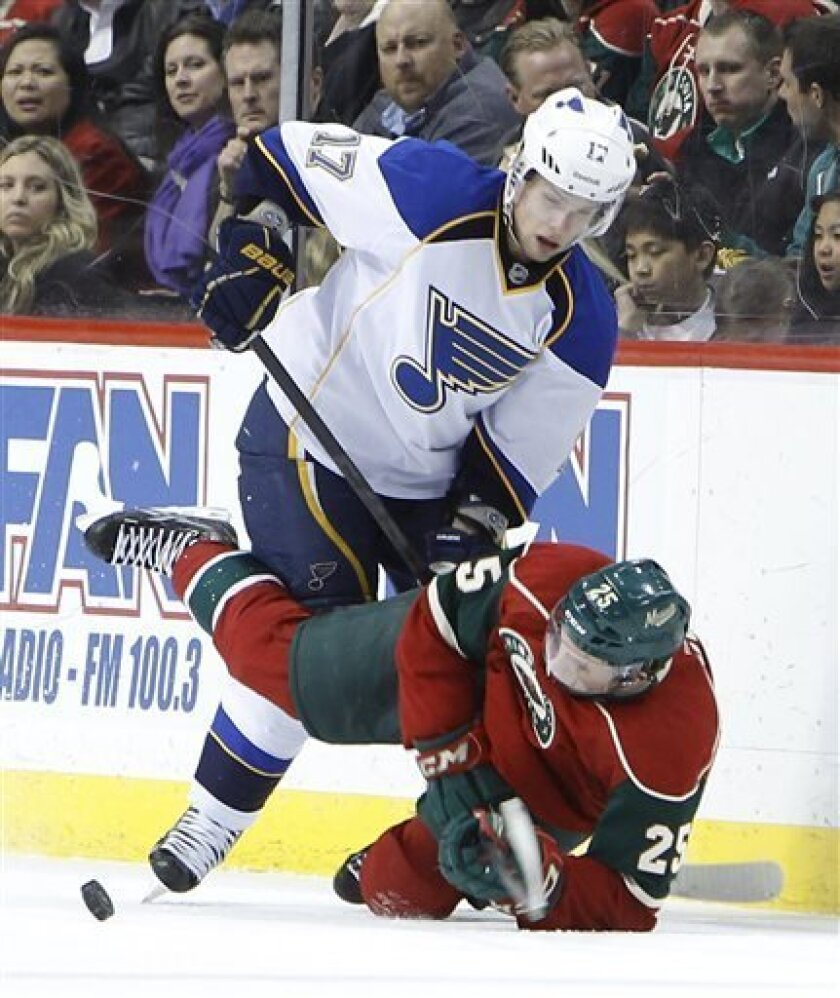 Minnesota Wild defenseman Jonas Brodin (25) falls as he and St. Louis Blues center Vladimir Sobotka (17) of the Czech Republic battle for the puck during the second period of an NHL hockey game in St. Paul, Minn., Monday, April 1, 2013. (AP Photo/Ann Heisenfelt)