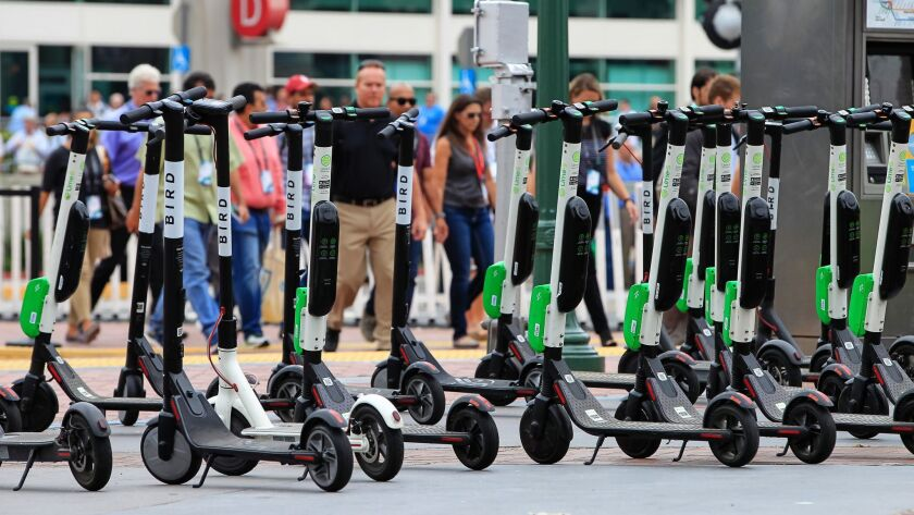 SAN DIEGO, CA July 10th, 2018 | All large number of rental scooters are parked near the Convention C