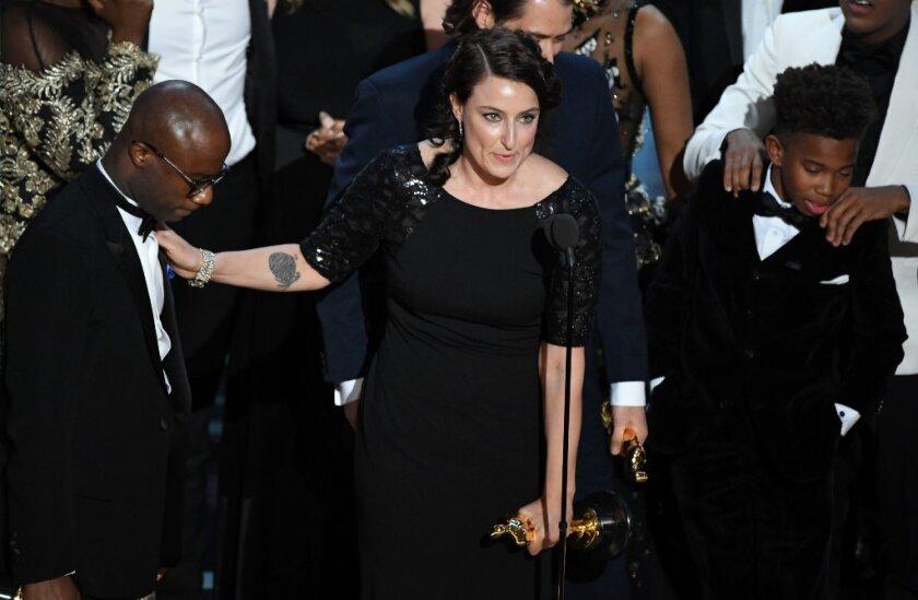 """Moonlight"" filmmaker Barry Jenkins and producer Adele Romanski celebrate the movie's best picture Oscar win."