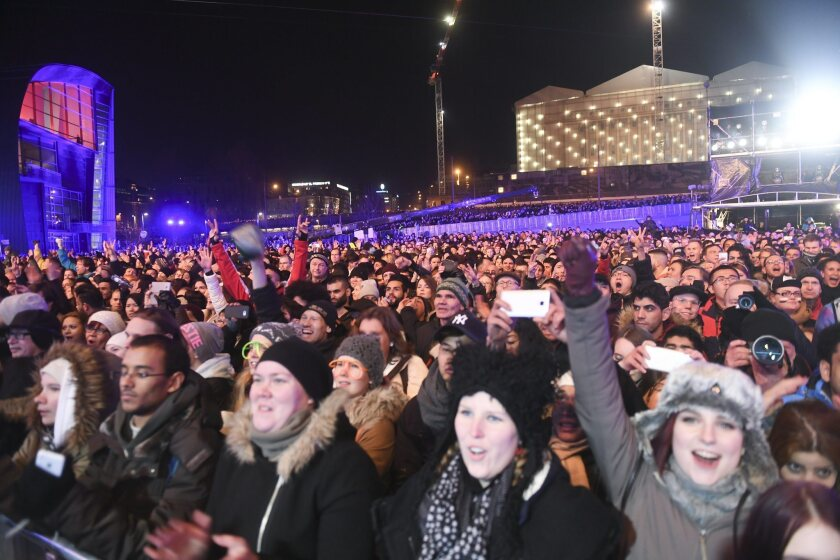 New Year celebrations in Citizens Square in Helsinki on Sunday. As part of an experiment, Finland will begin offering 2,000 citizens a guaranteed income, regardless of employment.