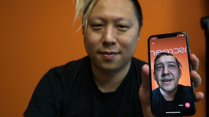 Pinscreen's Hao Li uses the app to superimpose another face onto his body.