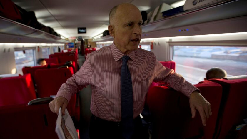 Gov. Jerry Brown speaks to journalists on board a high-speed train during his last visit to China in