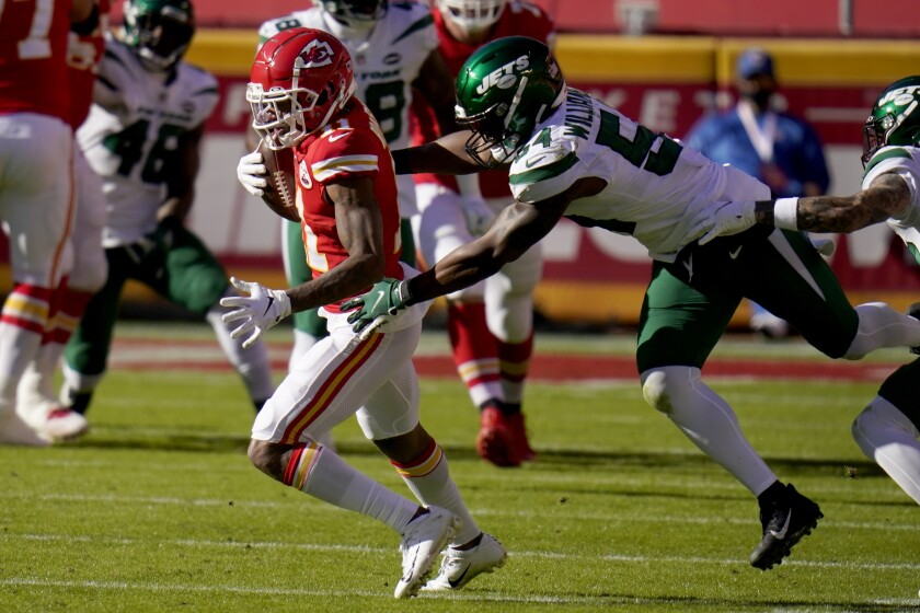 Kansas City Chiefs wide receiver Demarcus Robinson (11) catches a pass in front of Avery Williamson (54) in the second half of an NFL football game on Sunday, Nov. 1, 2020, in Kansas City, Mo. (AP Photo/Jeff Roberson)
